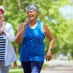 photo of active adults on a walking trail to advertise sun city peachtree amenities