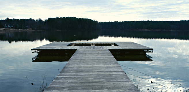 a lonely dock in lake acworth in the summertime