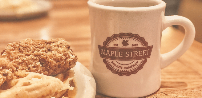 chicken biscuit and coffee mug in maple street