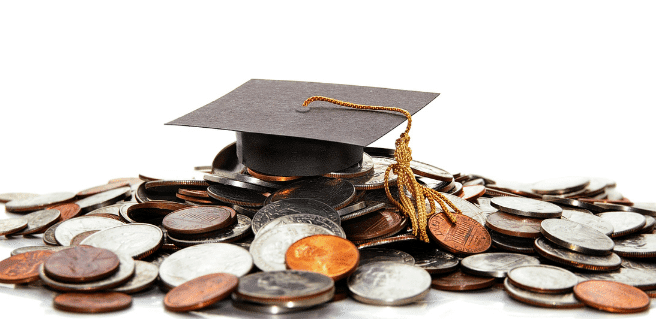 Student loan debt image with graduation hat on top of coins