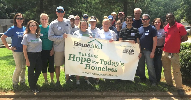 Group with HomeAid Banner