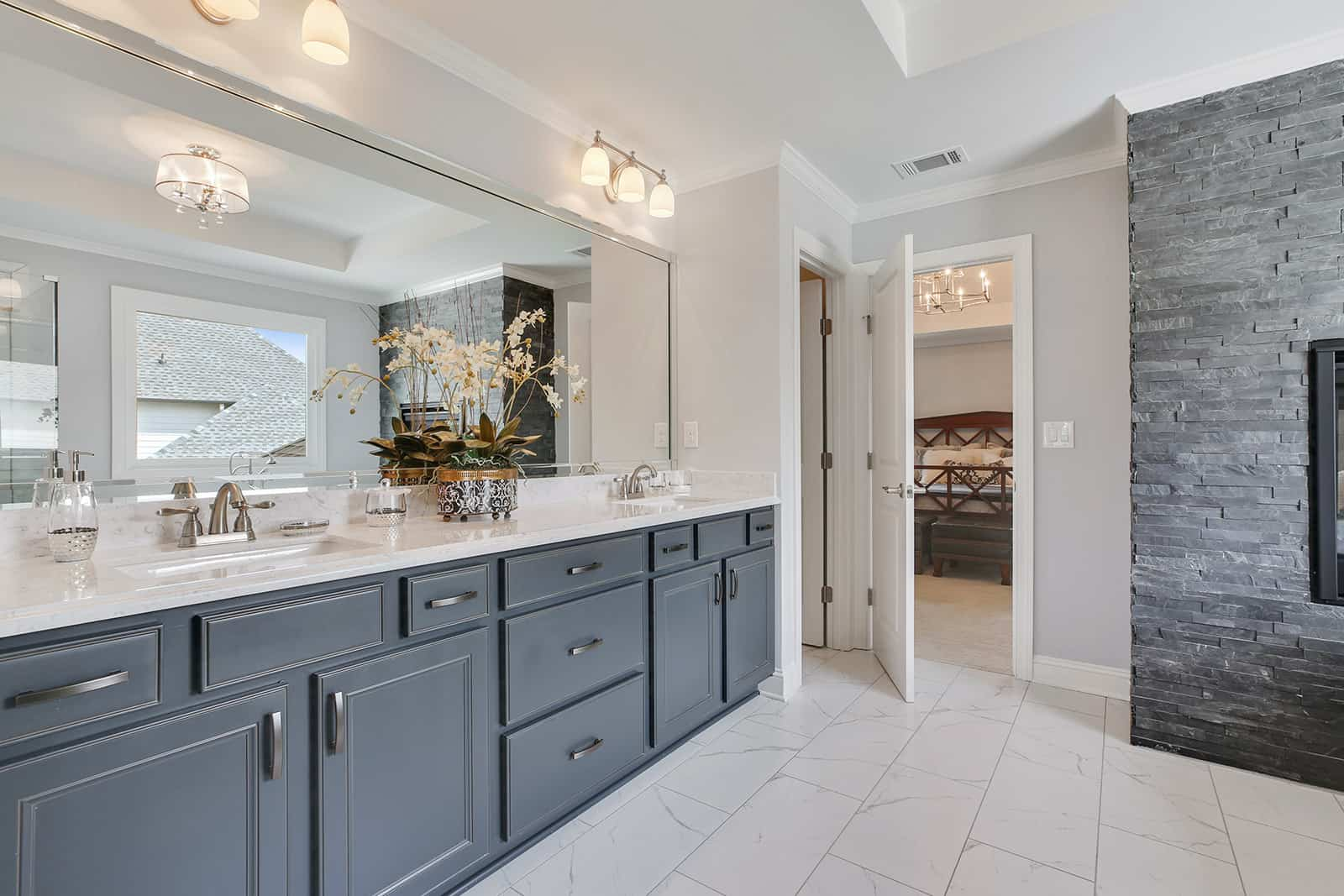 luxurious owners suite bathroom with dual vanities, soaking tub and frameless shower