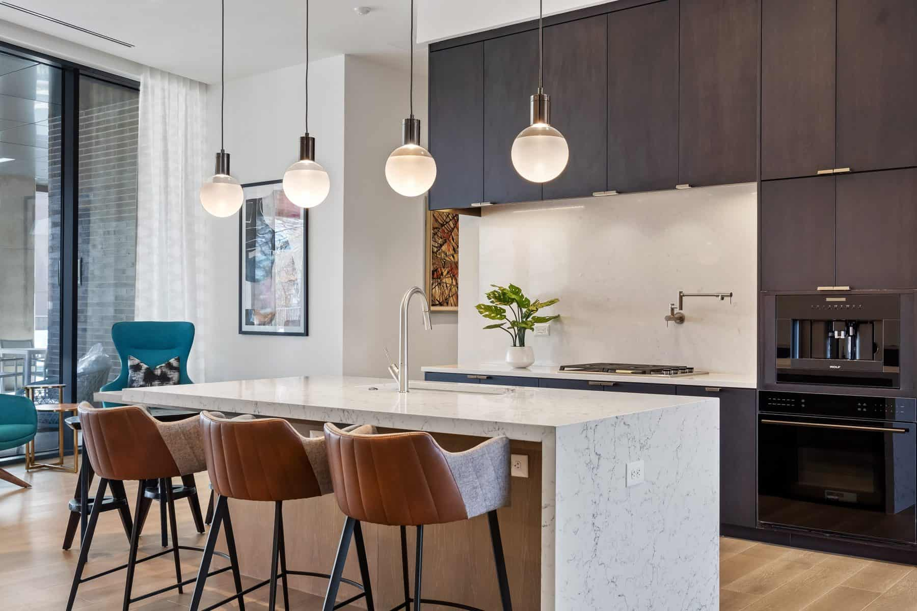 Seven88 West Midtown Demonstration Kitchen with pendant lighting, waterfall island with seating
