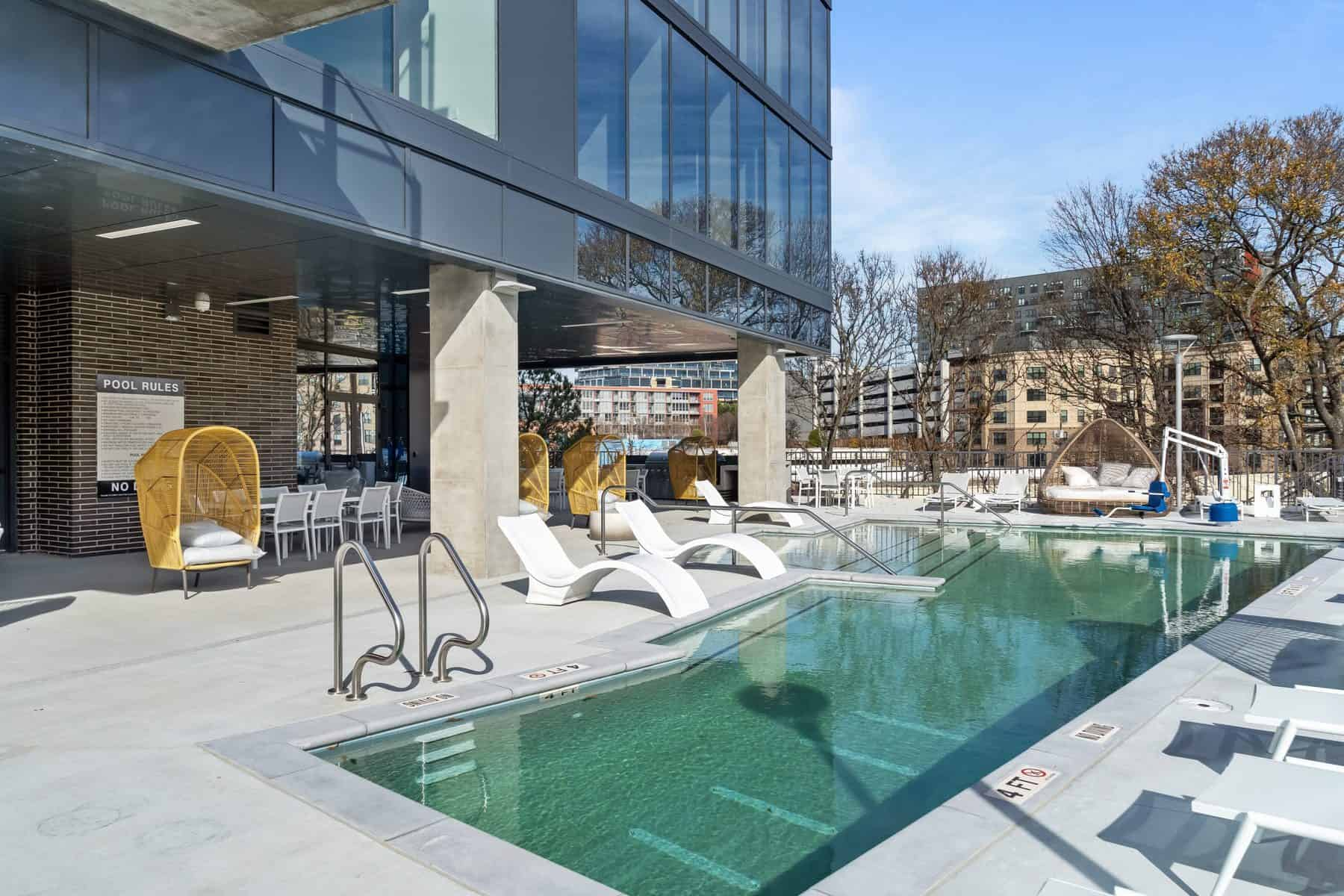 Seven88 West Midtown resort-style pool with lounge chairs