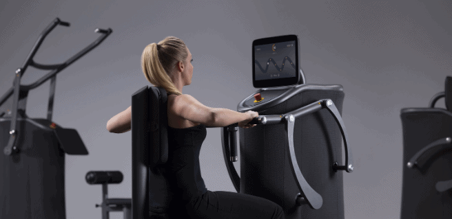 image of woman on EGYM fitness machine - coming soon to Cresswind Georgia at Twin Lakes