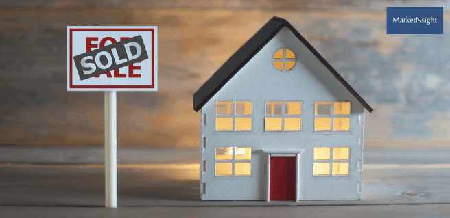 atlanta housing depicted by dollhouse with sold sign in front