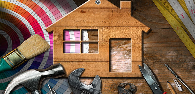 image showing a miniature house surrounded by tools to represent pre-summer home maintenance