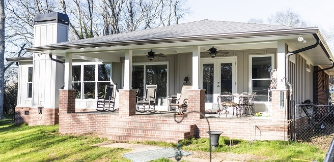 rear exterior view of covered porch at home addition and remodel in cartersville