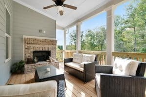 outdoor fireplace on covered porch