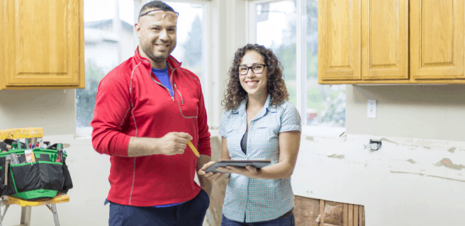 couple standing in kitchen during home renovation