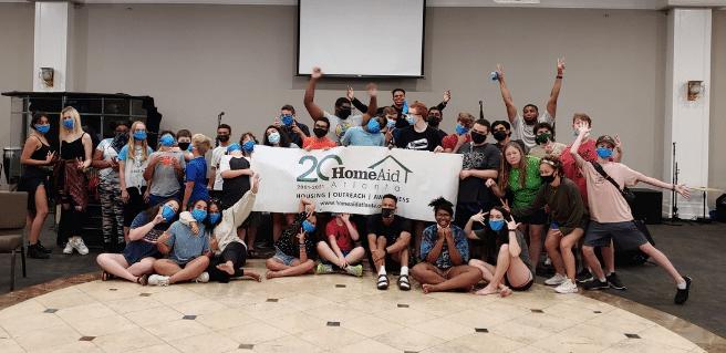 HomeAid volunteers celebrating packing 500 CareKits