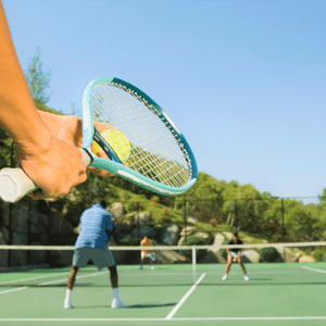 Photo of active adults playing tennis