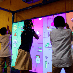 a photo of children playing in the rube goldberg exhibit at the children's museum of atlanta