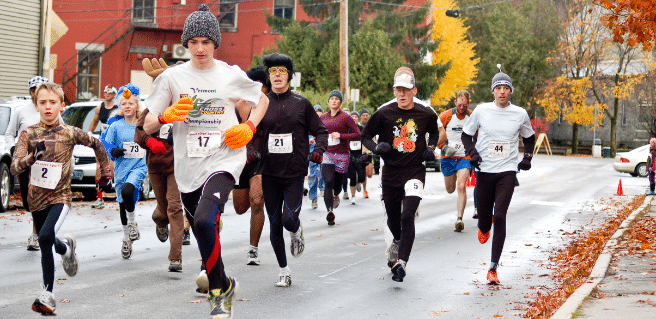 photo of runners participating in a fall 5k