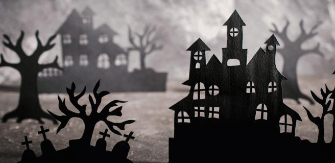 halloween graphic of houses and smoke to advertise metro atlanta's haunted houses