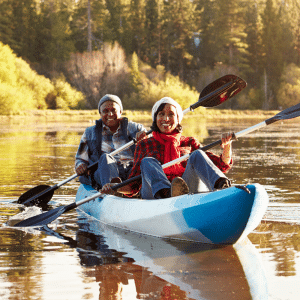 active adult couple canoeing to advertise the amenities at del webb at lake oconee