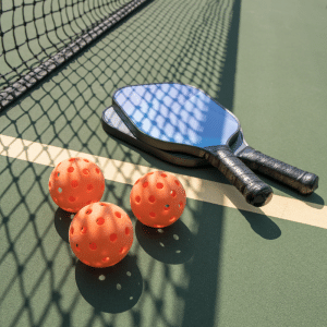 photo of pickleball paddles and balls to advertise the amenities at del webb at lake oconee