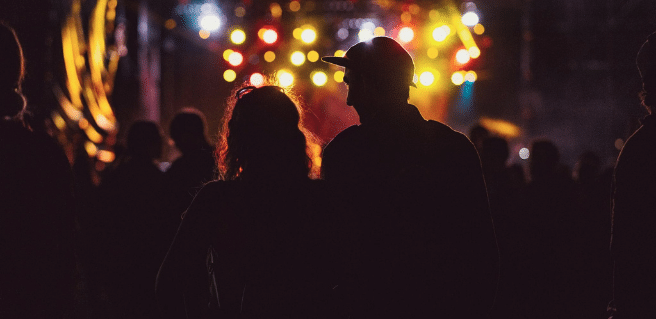 photo of a couple enjoying live music at sheila fest