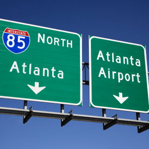 highway signs leading to atlanta and the airport to describe how close sun city peachtree is to these amenities